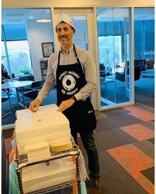 Donut Day is THE day for Outlookers! Throwback to Donut Day when our CEO & Co-Founder dressed up and passed out donut's through the office. This brought so many smiles to our team.   Thanks for the joy, Jason!   #donutday #lifeatoutlook #bringjoy #sugarrush #flashabackfriday